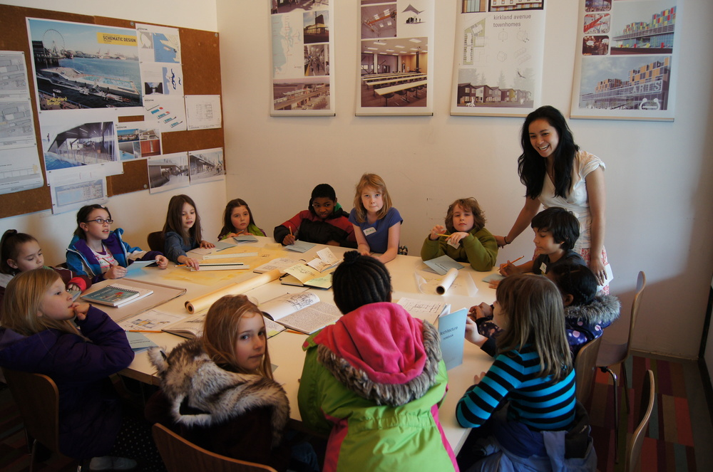 Mira leading a tour of Lowell Elementary Students through the Schemata Office