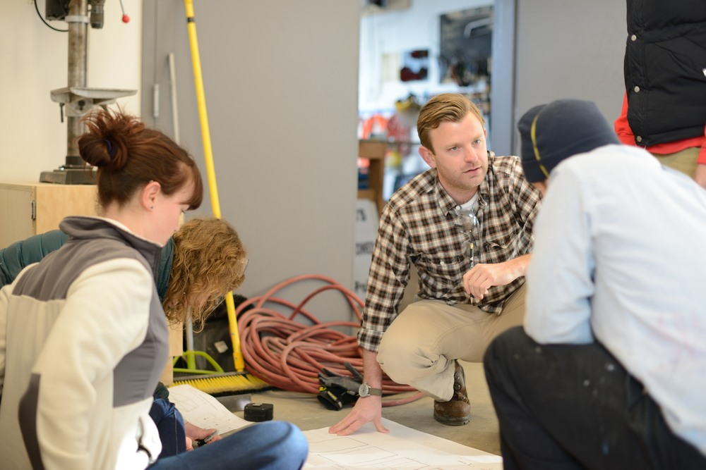 Scott discussing construction with Sawhorse Revolution students