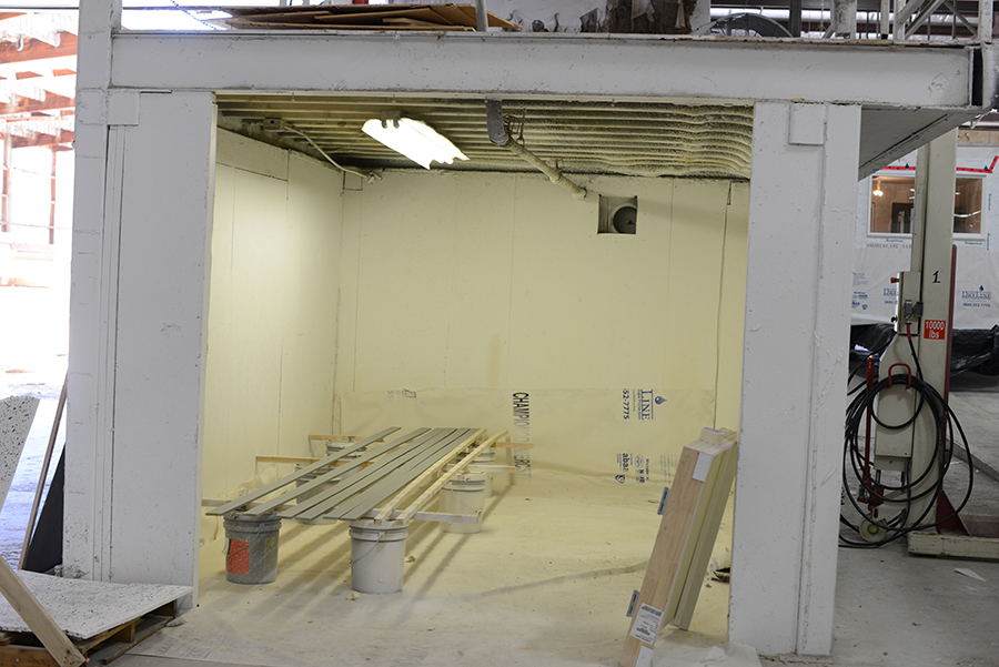 In a separate paint booth finishtrim for base, door and windows ispainted