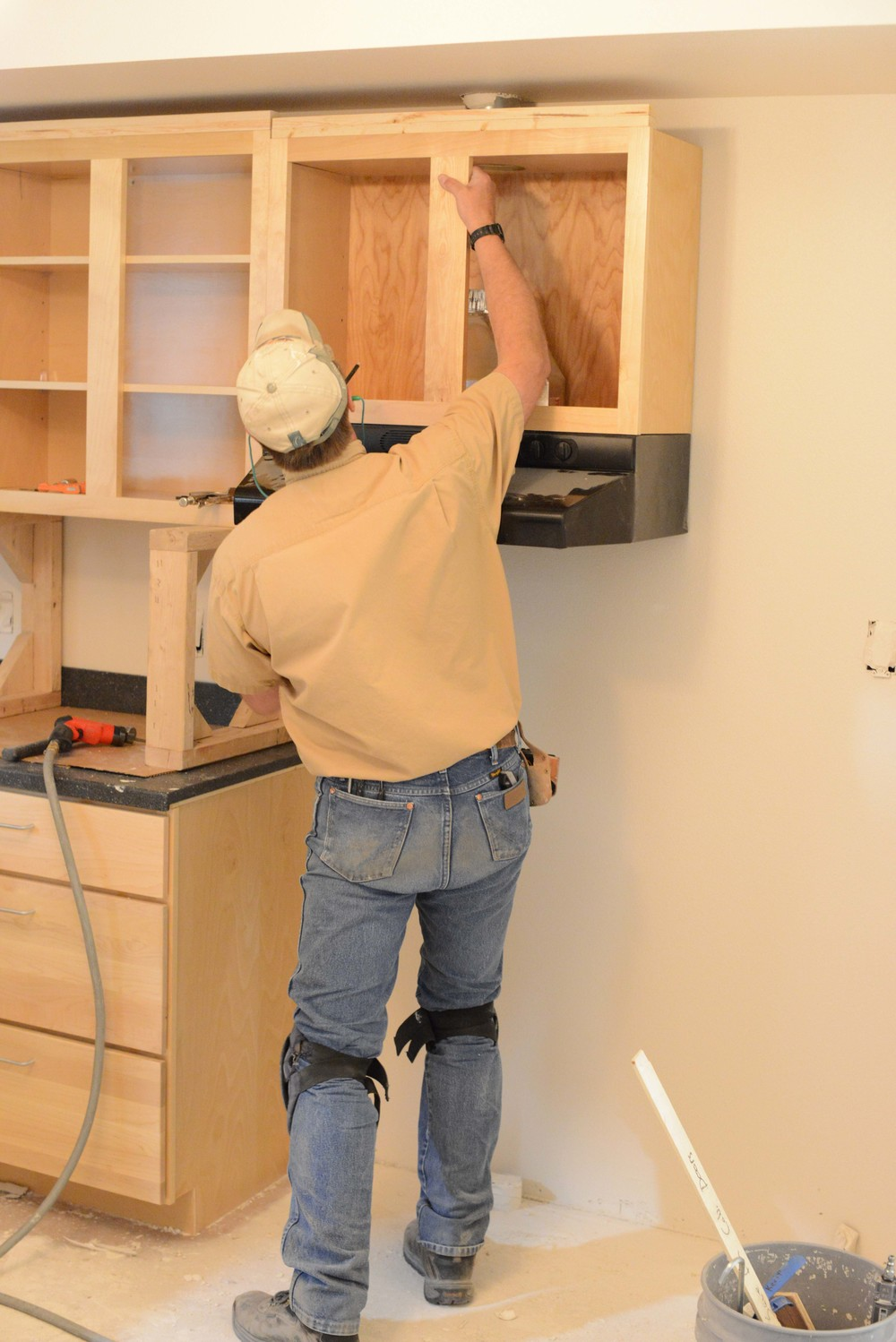 Doors are hung on their jambs and the upper cabinets are installed. At this time the electrical fixtures are installed.