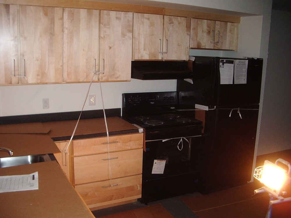 Appliances are installed and the units are almost ready for shipment.  Protection board is placed over any surface that could possibly incur damage during shipment or subsequently during the on site button up.