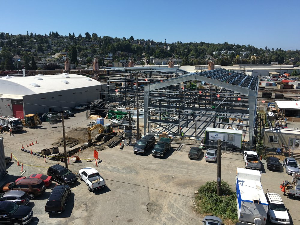 Aerial view of R&D Building steel PEMB frame from adjacent rooftop.