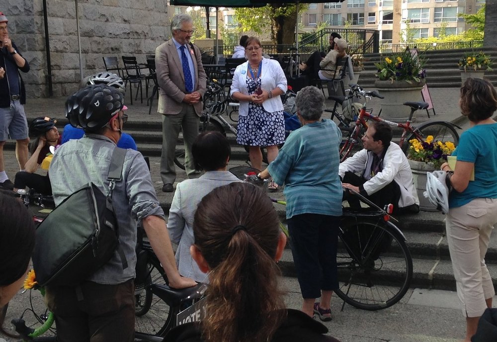 City of Vancouver councillors Geoff Meggs and Heather Deal addressing bicycle advocates prior to a mass vote during the 2015 Metro Vancouver Better Transit & Transportation Plebiscite. The plebiscite failed to pass.