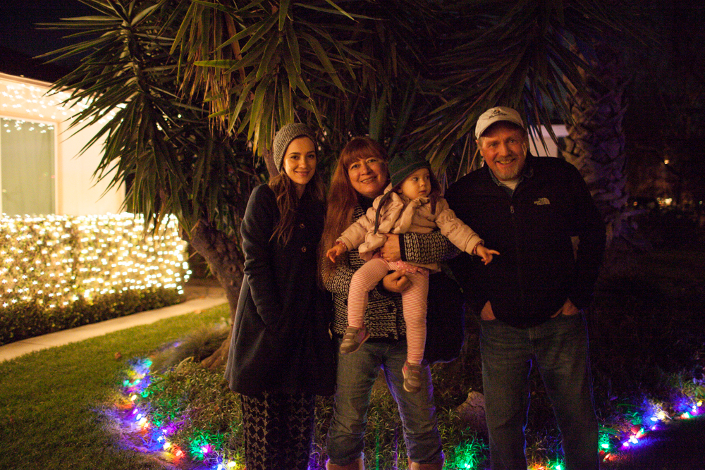 In front of the house by the Xmas lights
