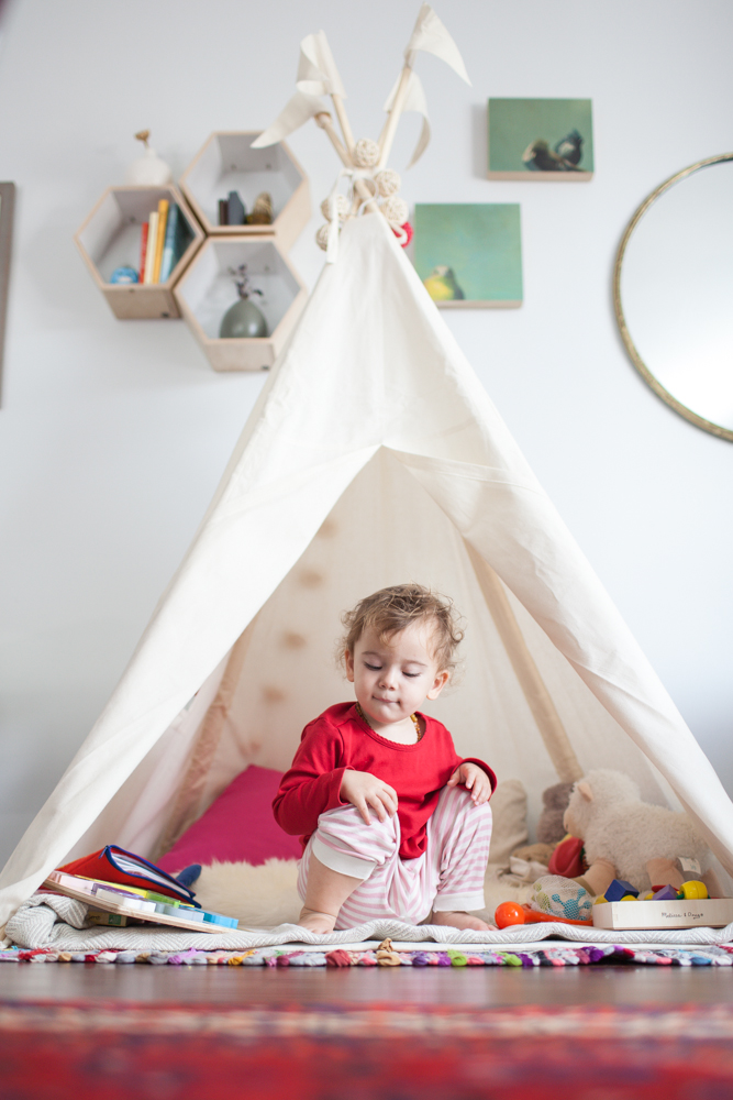 A portrait of Naomi, once a week, every week, in 2014  - Getting comfortable in her new teepee. -