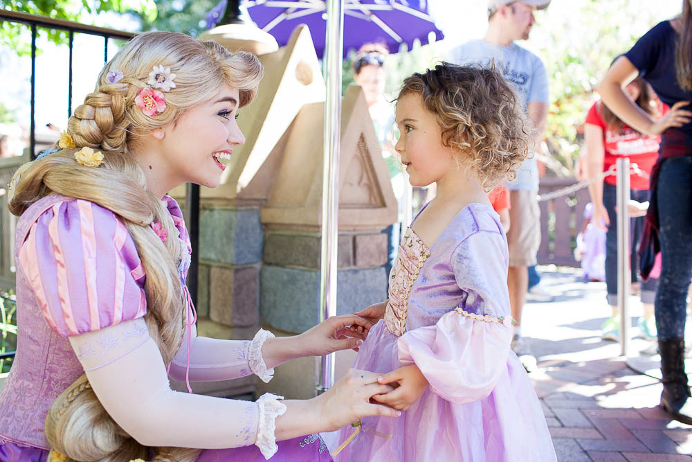 Meeting her favorite Princess, Rapunzel, for the first time. They were in awe of each other!