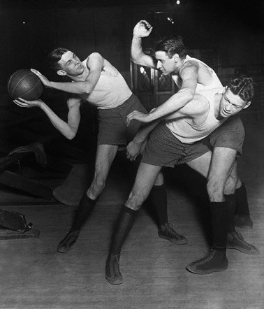 calumet412 :     University of Chicago basketball team members posing in play position, 1920, Chicago.