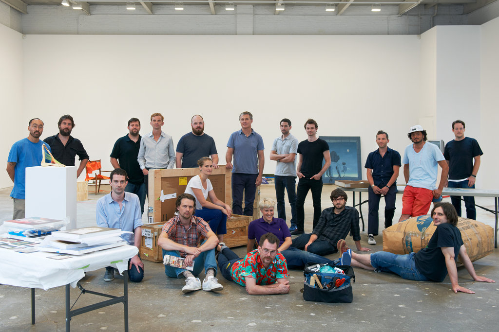 """installator :     """"The artists in the group show """"People Who Work Here,"""" during the installation at David Zwirner in Chelsea. Back row, from left: Brent Harada, facilities assistant; Clive Murphy, art handler; Chris Medina, director of operations; Chris Rawson, archivist; James Morrill, controller; David Zwirner; David Ording, art handler; Justin Davis Anderson, art handler; Sam Martineau, art handler; Ramon Silva, art handler; Josh Brown, art handler. Seated on crate: Aidan Sofia Earle, art handler. Seated on floor, from left: Aengus Woods, art handler; Cy Amundson, art handler; Joel Fennell, head art handler; Liz Neilsen, inventory manager; Justin Phillipson, new media coordinator; Dave Miko, art handler. Not pictured: Ben Berlow, registrar. Jason Schmidt, courtesy of David Zwirner, New York"""" ( NYTmagazine )"""