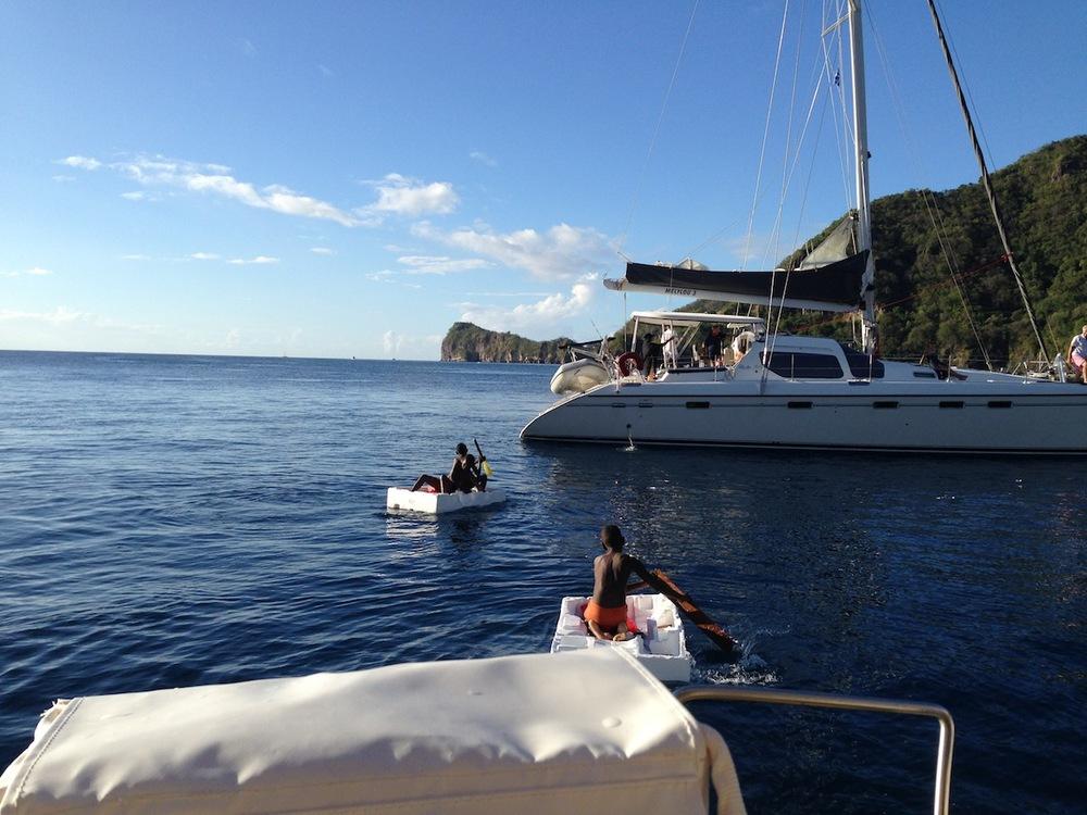 Soufirere - ett gäng barn kom på besök i sina 'båtar' av frigolit!