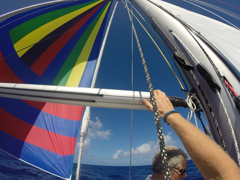 Going out on the pole to re-lead a sheet before gybing the A sail.