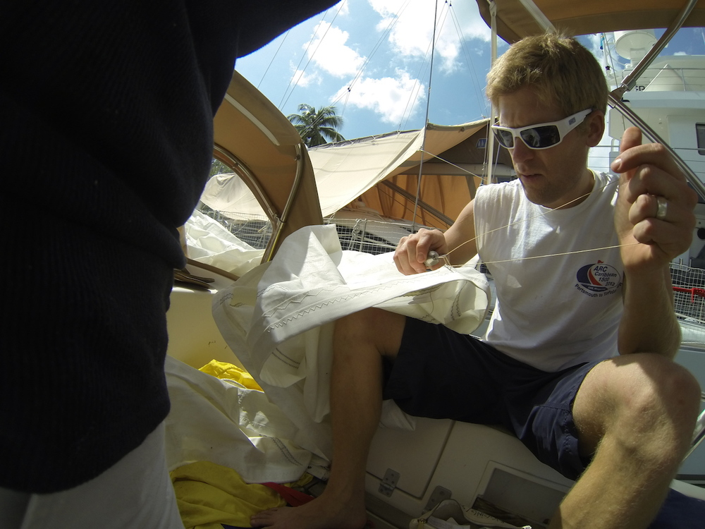 Hand-stitched sail repair on the solent jib in St. Lucia.