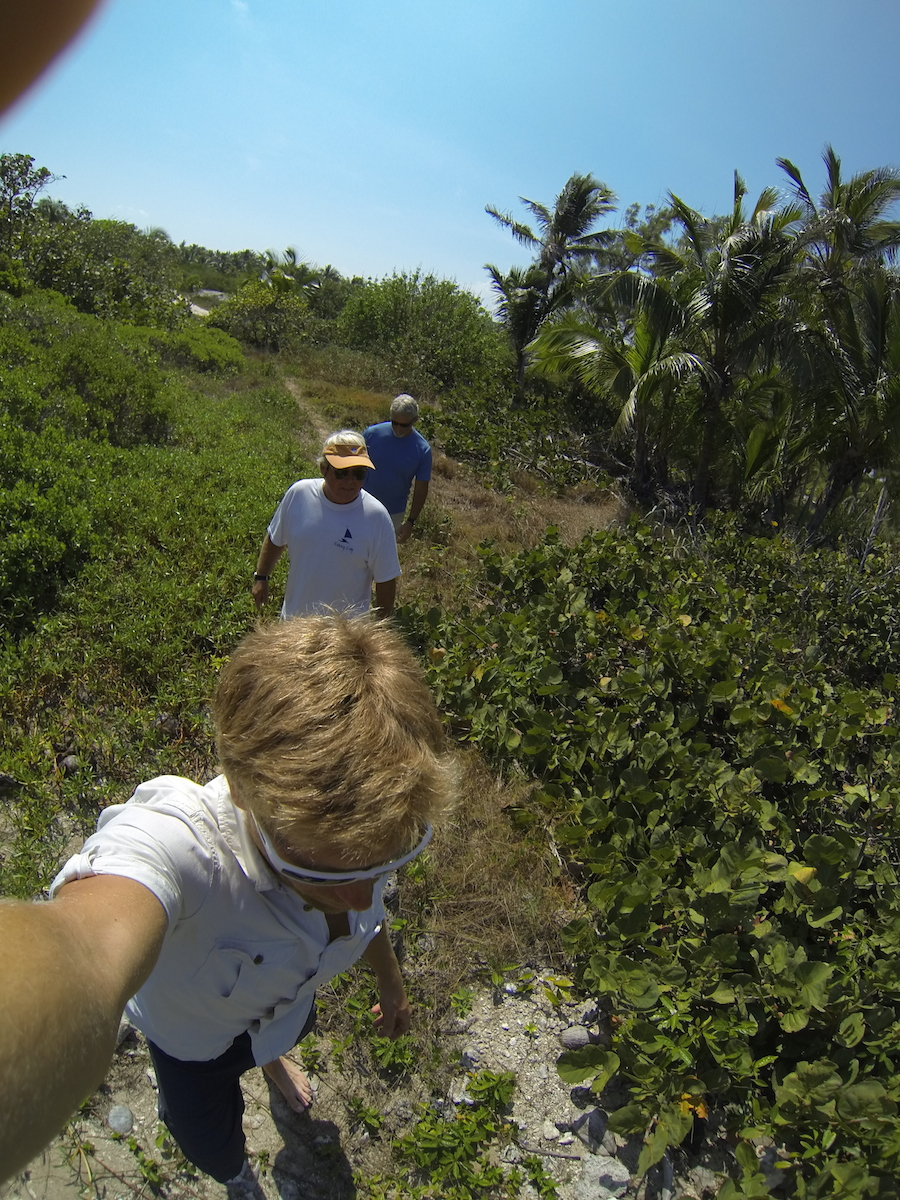 Hiking to the abandoned lighthouse at the cut where we ran the reef break two days earlier.