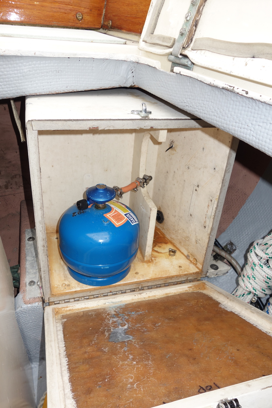 Propane locker in port cockpit locker.