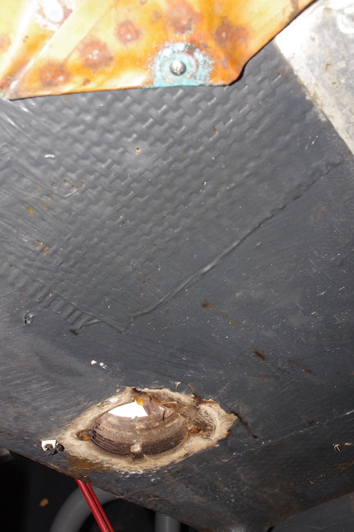 Underside of cockpit sole - this access hole is for emergency tiller.