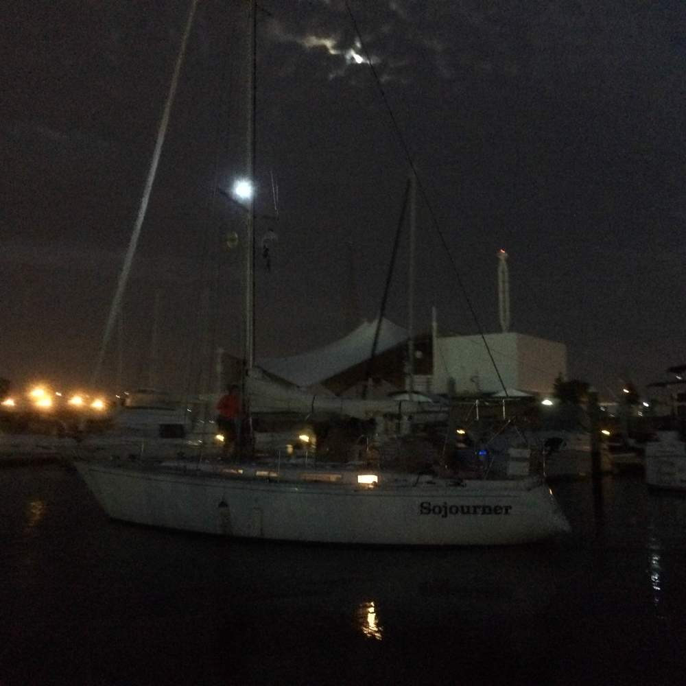 Sojourner departs Portsmouth in the pre-dawn darkness, bound offshore for Cape May.