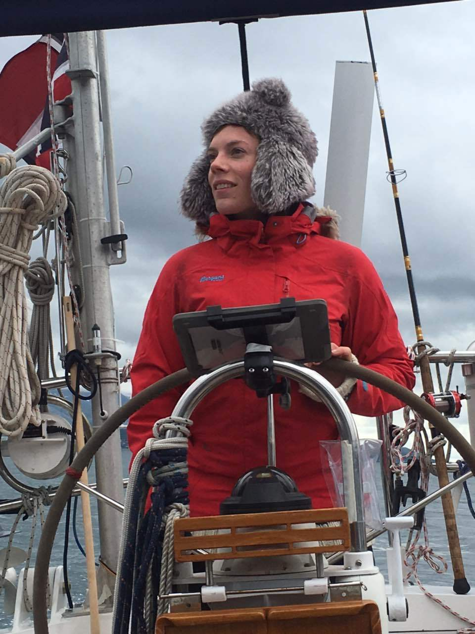 Kari at the helm in Northern Lat.