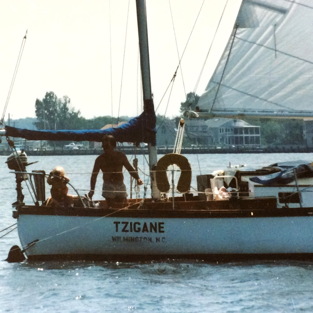 Dad & Andy on 'Tzigane,' mom & dad's Kaiser ketch, in Annapolis, circa summer 1984/85.