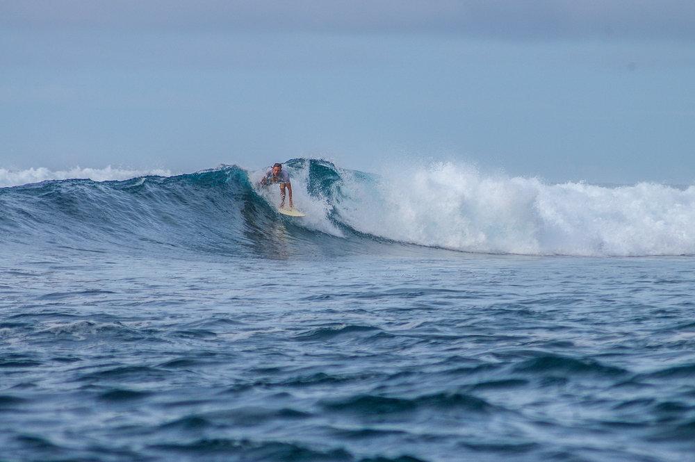 Alex surfing.