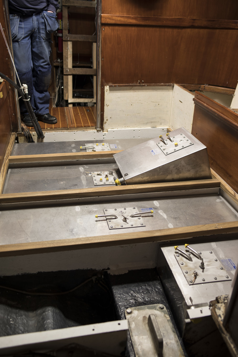 Painted bilges, new tanks ready to go in, and new teak under the floorboards.