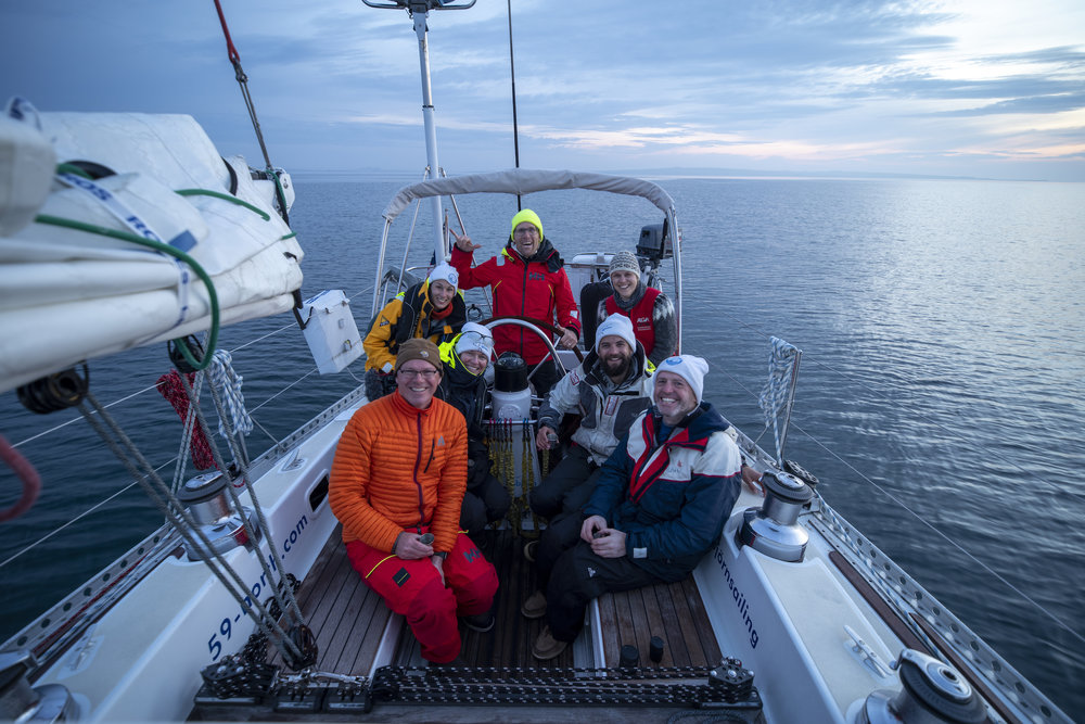 The crew at our landfall in Orkney at dawn, following the successful passage! From left to right - Front: Brian, Susan, Ben, Rob; Back: Sophie, Andy, Mia.