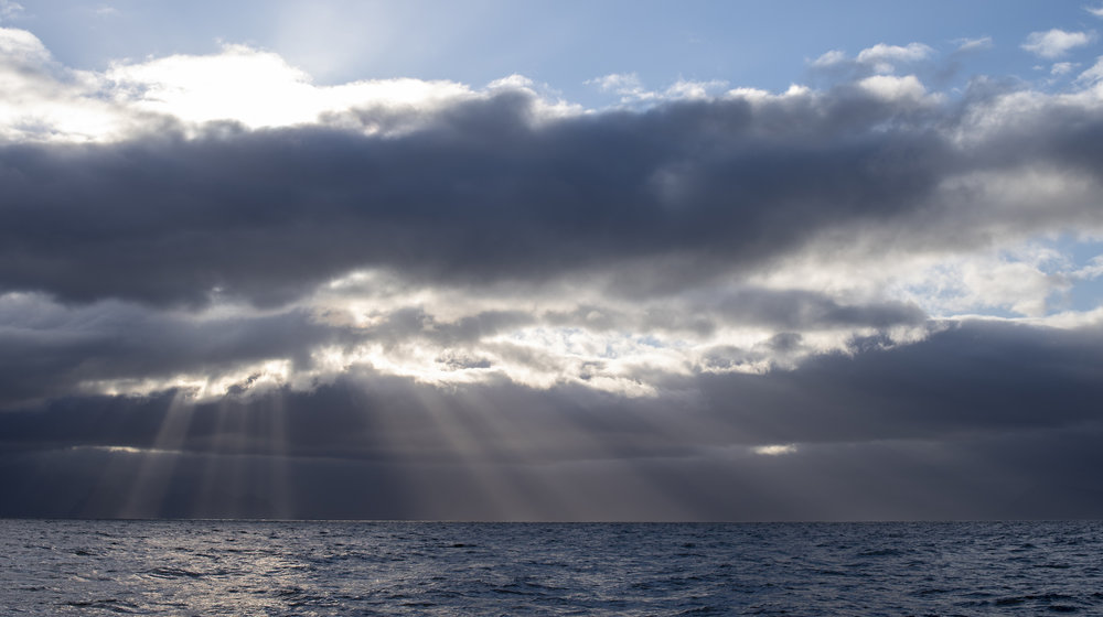 Late afternoon sunbeams in the Vestfjord after leaving Reine.
