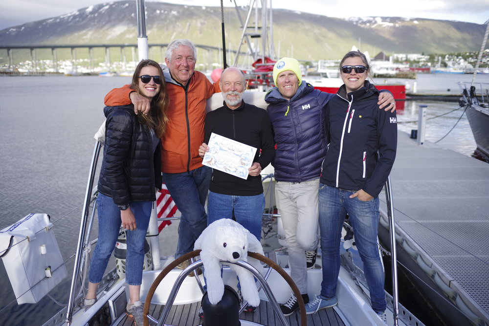Tromsø! Happy crew (and the Isbjorn mascot) celebrate our arrival in the gateway to the Arctic.