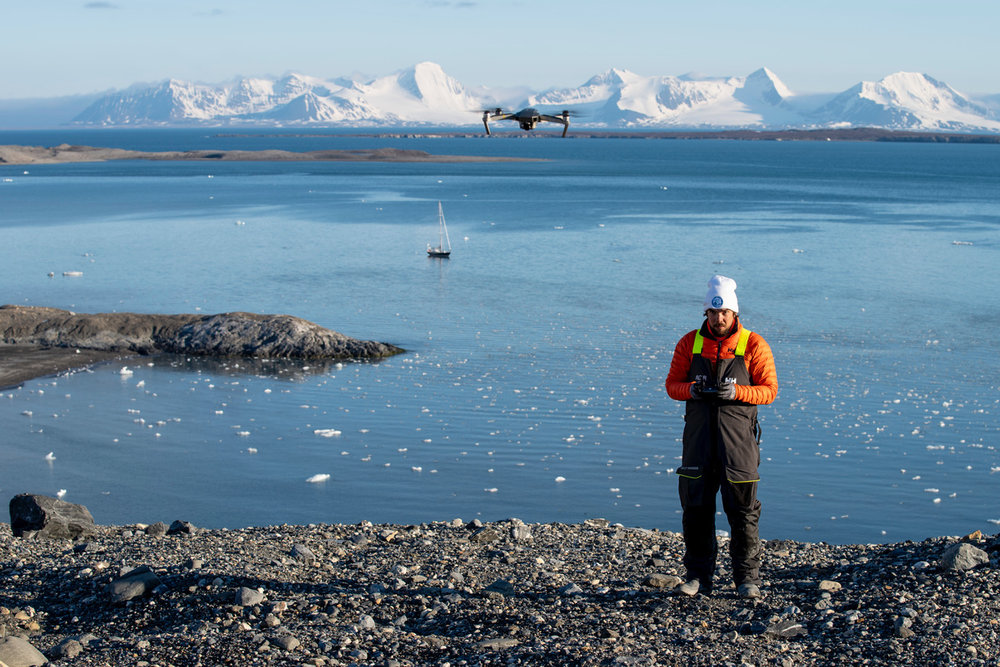 Brady of S/V Delos launches a Drone amongst the Arctic mountains and Isbjörn