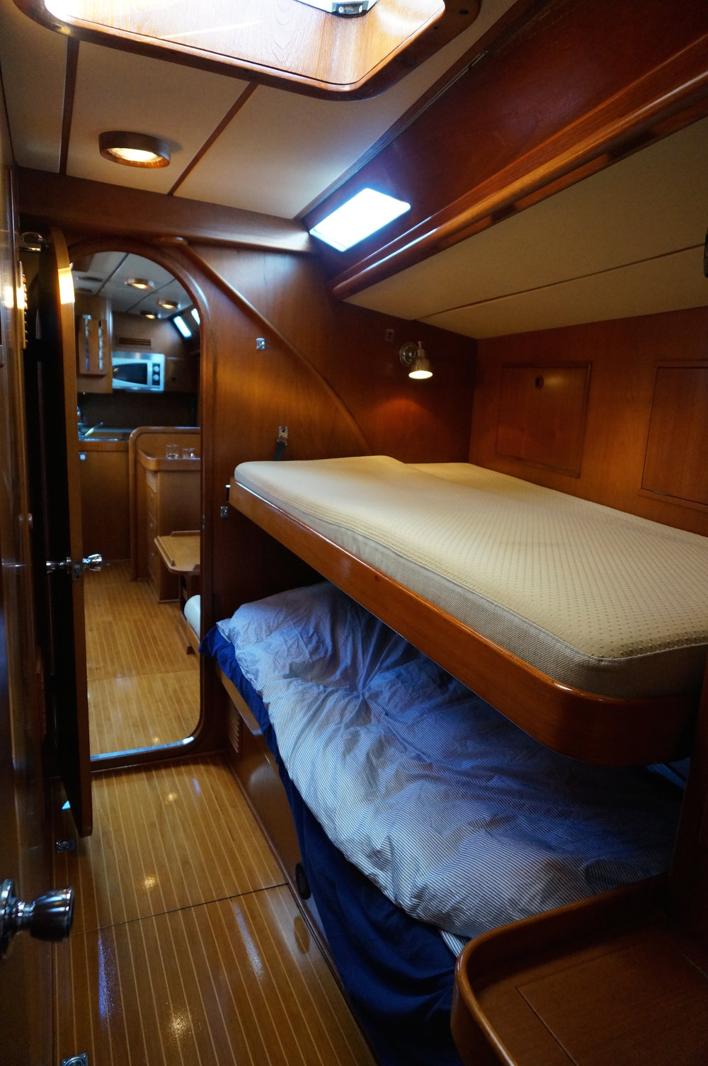Crew cabins port and starboard with single bunk beds. Another crew cabin forward for two more. We can now take 6 crew offshore, plus Mia & Andy.