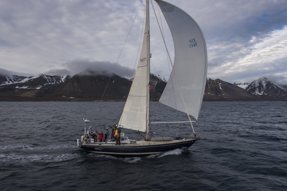 The last sail with the s/v Delos gang. Spinnaker blasting at 0200 in the midnight sun!
