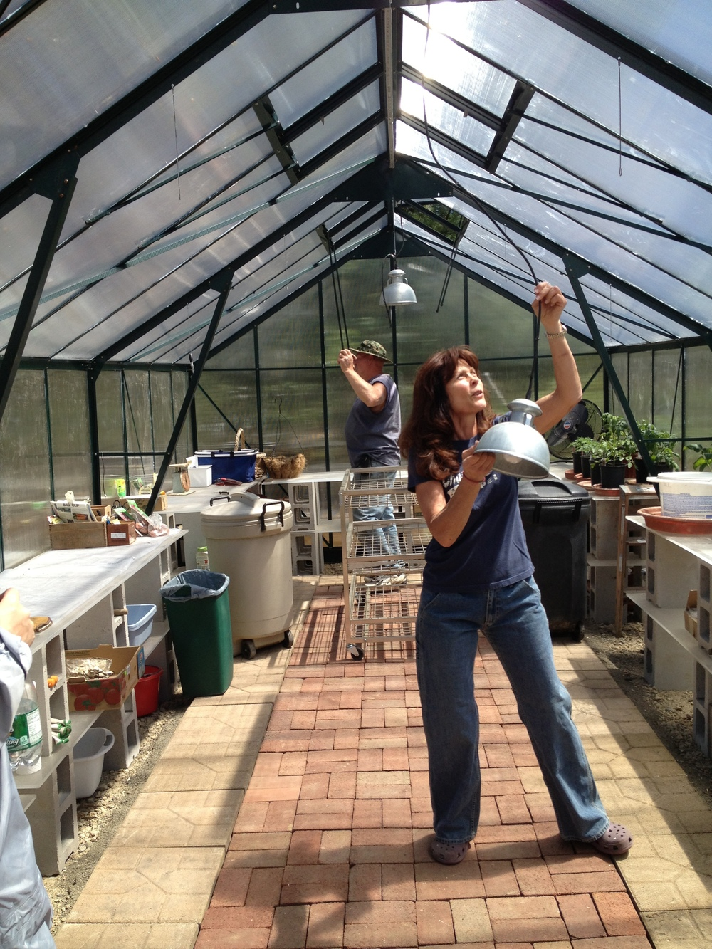Wayne and Linda in the greenhouse. The lighting is so multi-functional - we are able to unhook it and rehang it over our workspace.