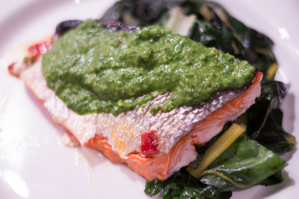 Thai Basil Pesto over an oven roasted wild salmon with swiss chard.