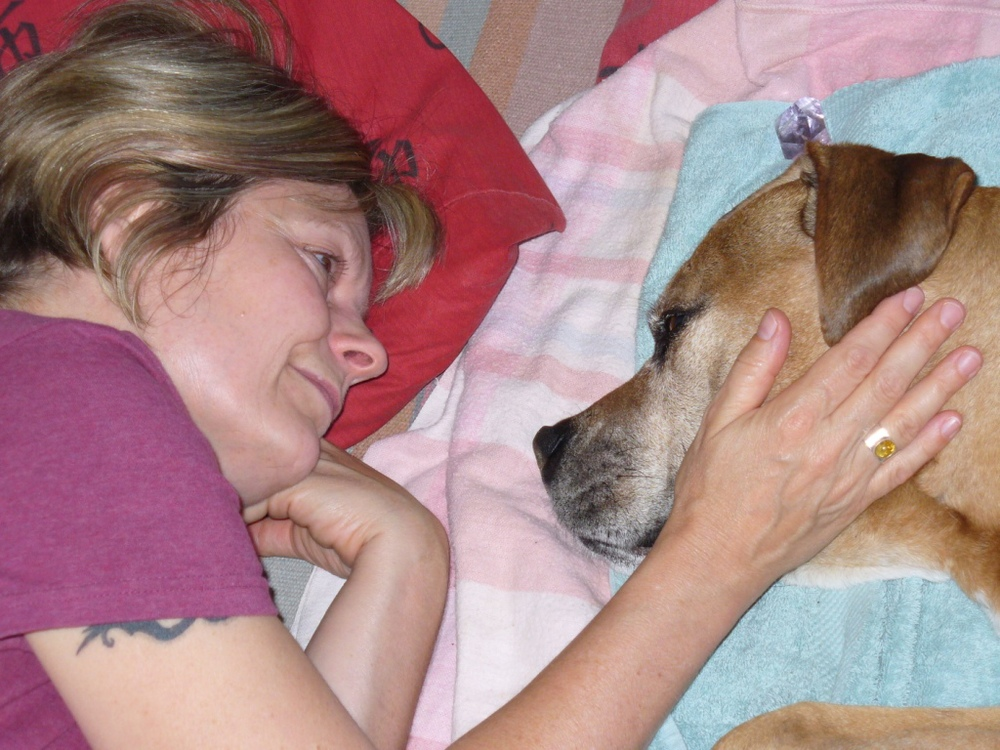 Ute with her soul dog Shiva during his last moments before passing.