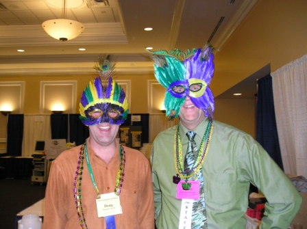 Glenn with Dr. Doug McInnis during a Mardi-Gras themed conference.
