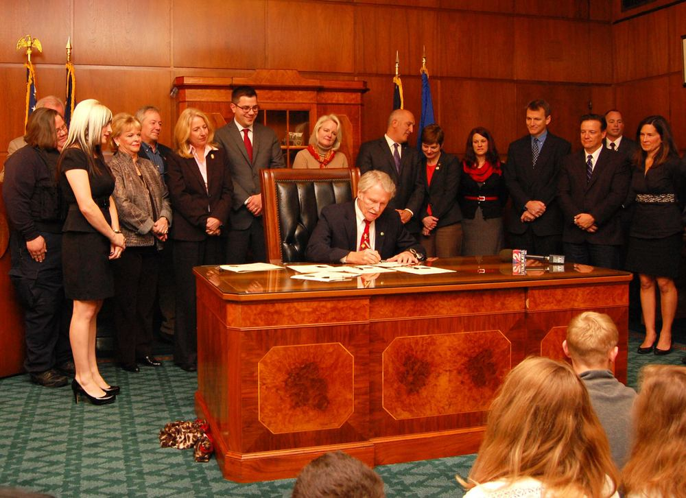Signing of Oregon's Anti-Tethering Law (Wendy far left)