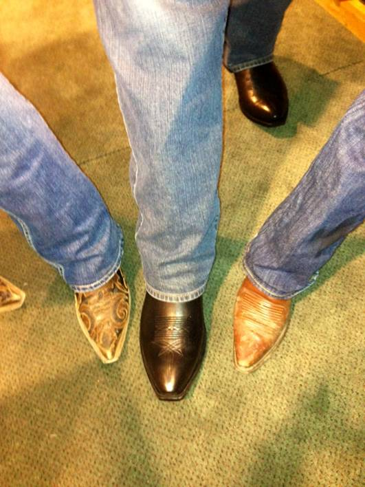 Justin Boots are Justin's shoe of choice…he's the one in the middle.