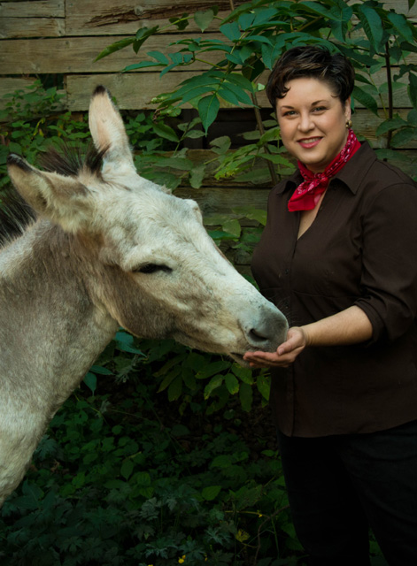 Jo pictured with Ollie the Donkey, one of several livestock she was caring for the week Ferdinand found (and lost) his independence.