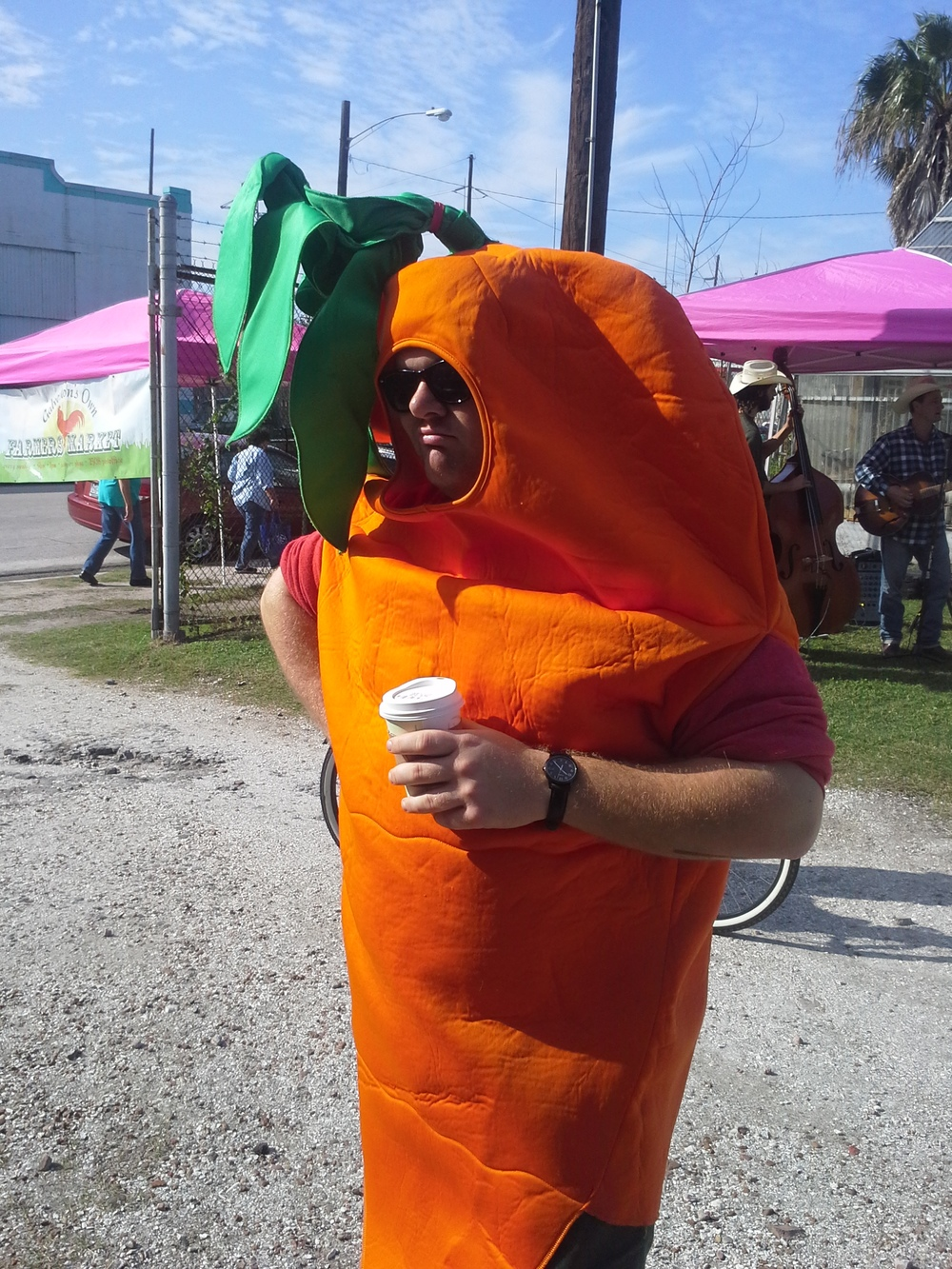And he does it ' cause he loves salads so much. (Michael, our unofficial mascot for the Galveston's Own Farmer's Market)