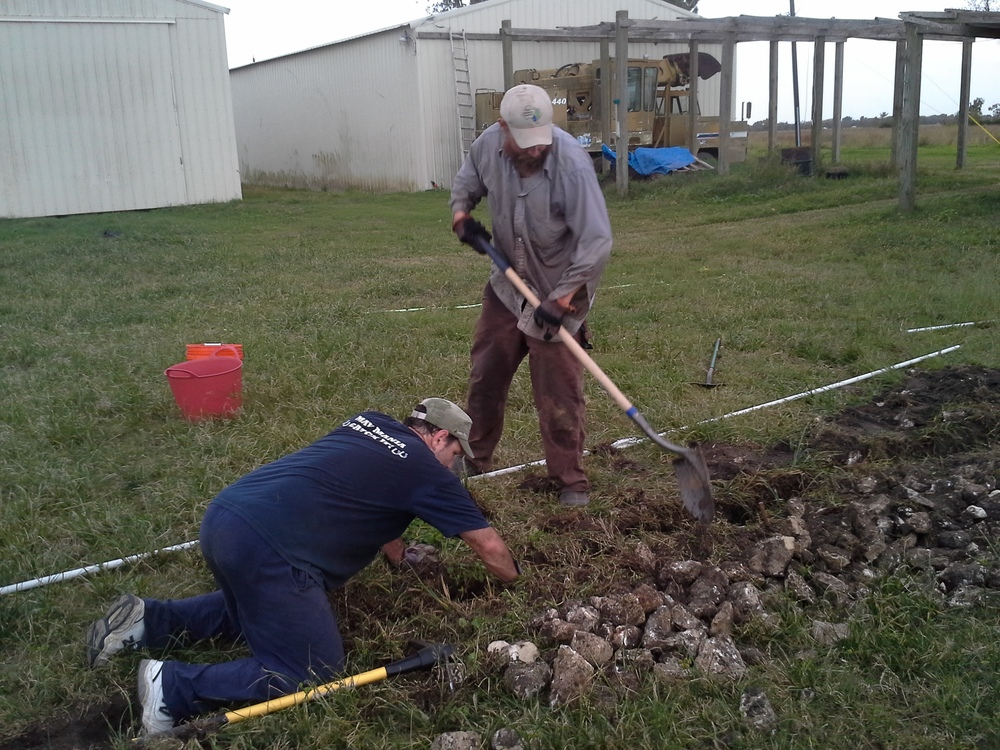 Jerry did the dirtiest work, tearing and pulling at the fabric supporting the rocks. Alex shoveled his heart out.