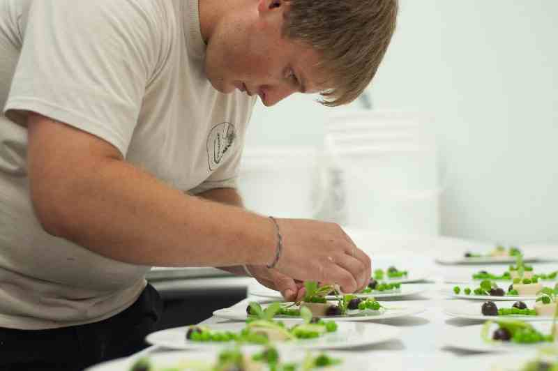 Chef Ross Warhol constructing something taaasty. (And might that be Moon Dog Farms' peas?)