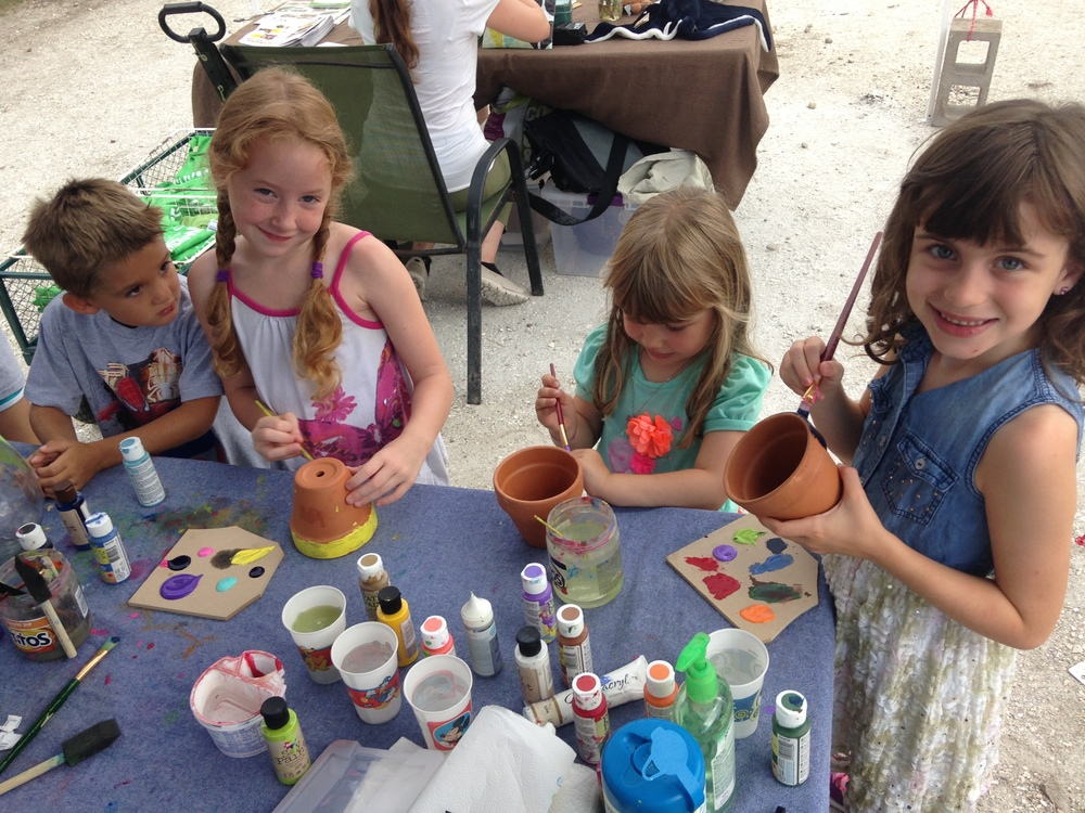The kiddos at Kids' Corner, our monthly GOFM event that lets kids run wild with food, paint and plants!