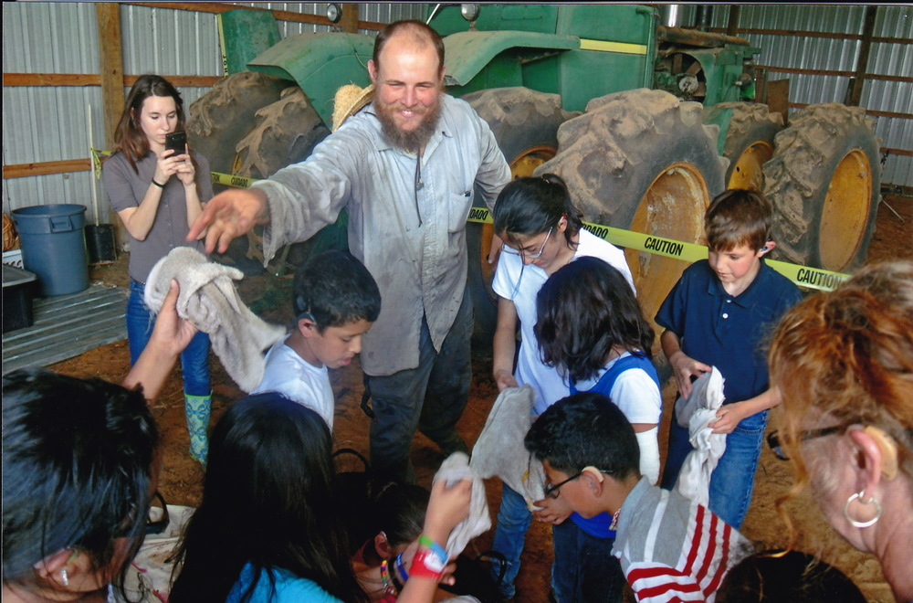 We teach kids about the realities of farming as well, including how to wash potatoes to take to the farmers' market.