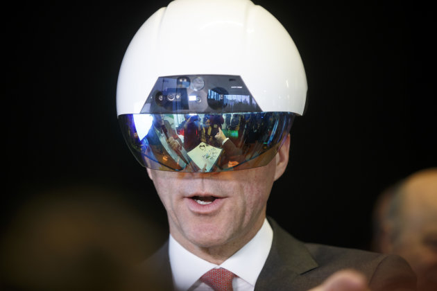 Bill Morneau, Canada's finance minister, tries on a virtual reality helmet during an artificial intelligence demonstration at the Vector Institute inside the MaRS Discovery District in Toronto, Ont., on March 30, 2017.