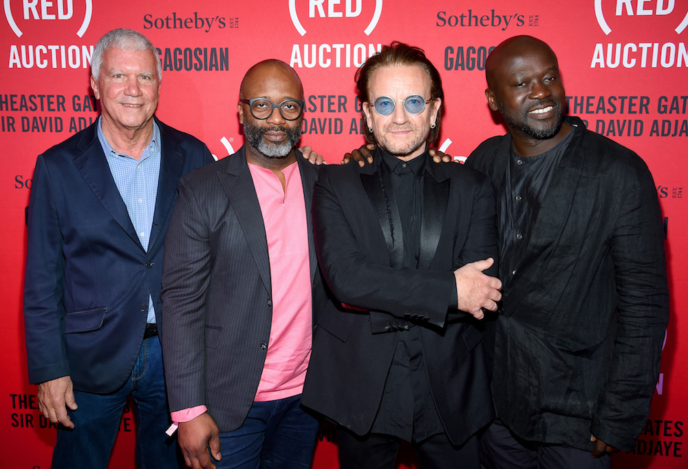 Larry Gagosian, Theaster Gates, Bono, and David Adjaye attend The (RED) Auction with Theaster Gates, Sir David Adjaye and Bono, in collaboration with Sotheby's and Gagosian at The Moore Building on December 5, 2018 in Miami, Florida. (Photo by Dimitrios Kambouris/Getty Images for The (RED) Auction 2018)