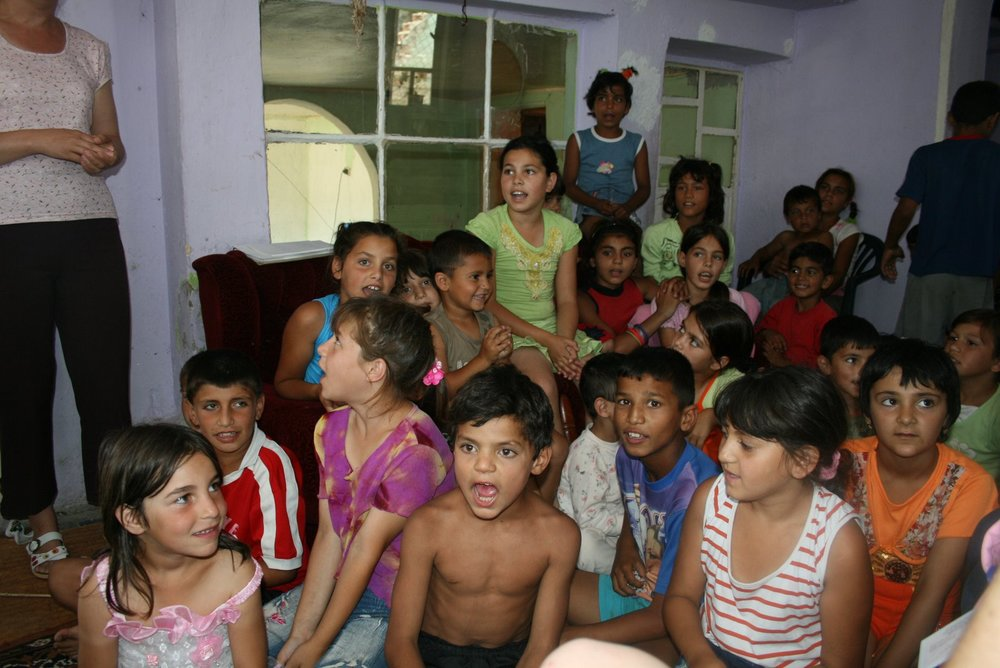Bulgarian children in a impoverished Roma neighborhood sing Christian songs led by the Russe United Methodist Church.