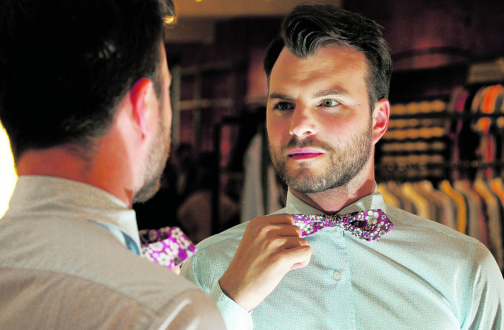 Chad Helm, owner of The Helm, a menswear clothing store in downtown Edmonton, wears a floral shirt and bow tie. He says men's floral is seeing an evolution and is expected to flourish this fall.  Photo Credit: Larry Wong/Edmonton Journal