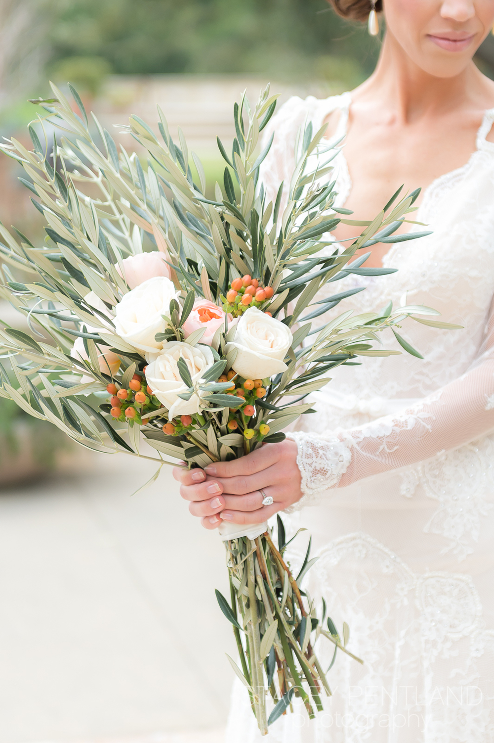 Pretty florals, the perfect combination of olive branches, roses and berries by  Floral Designs by Reina  .