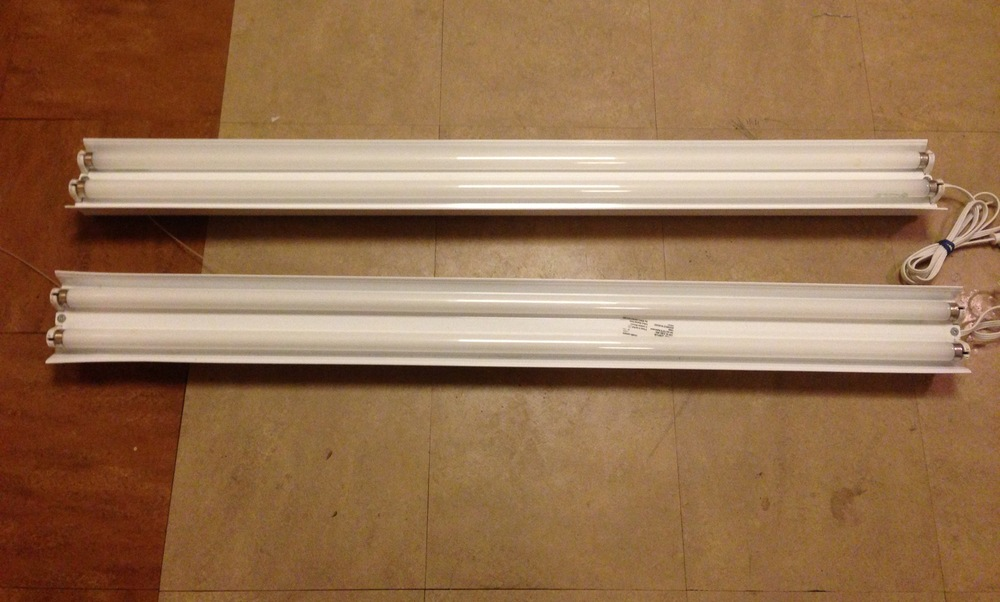 """4ft Fluorescent Lighting Bank"" (2) 2 ""T8"" Bulb housing 64w each."
