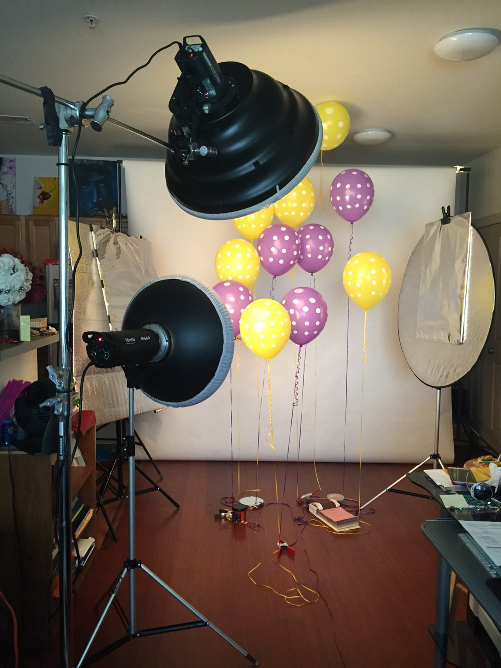 Getting ready for the shoot, using some A clamps to hold down the balloons.