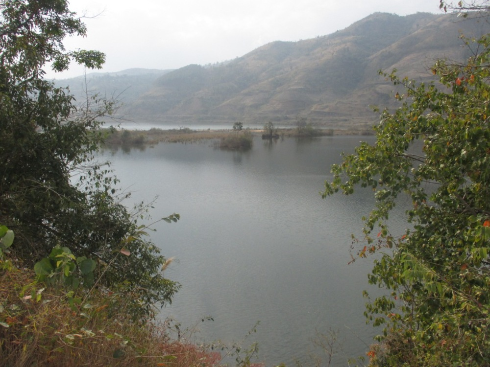 Mapithel Dam reservoir submerging agriculture and forest land