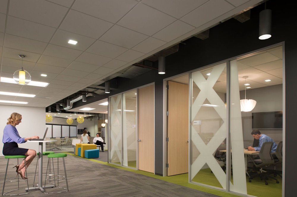 Open office layout with dedicated focus rooms  = balance of flexibility and privacy, freedom of choice